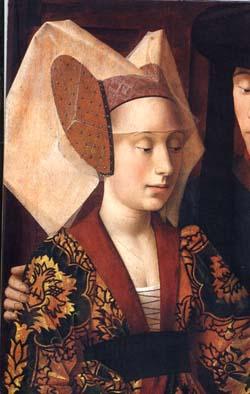 non solo il volto ma anche le spalle e un diadema lo incollava alla fronte.  Portavano anche immensi cappelli a cono con velo